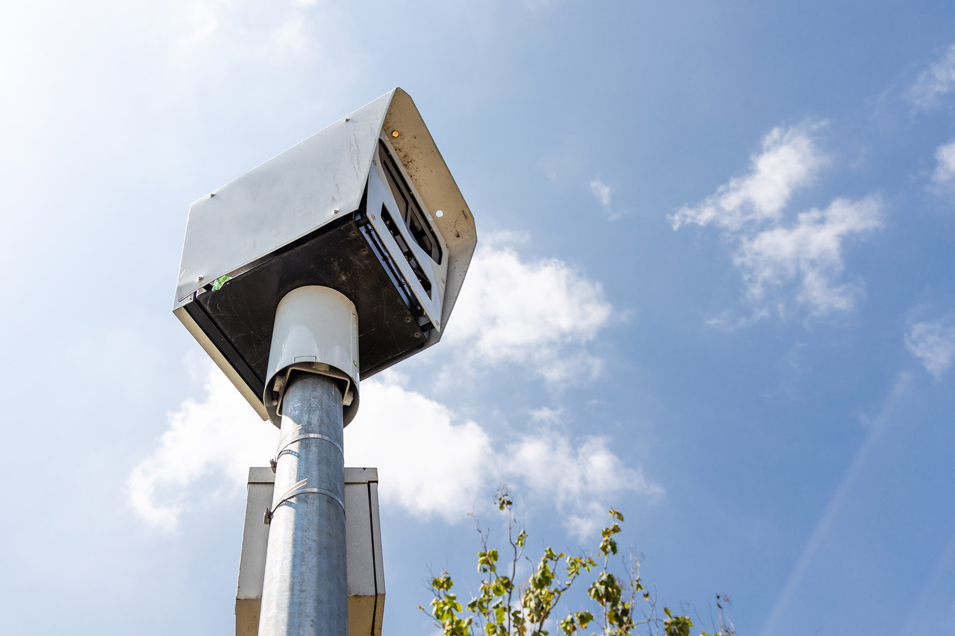 Close-up on Speed Trap Surveillance Camera Along Highway